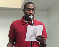 HU World AIDS Day Coordinator Devin Jones opens the event in the Student Center.