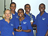 Dr. Donna Wilt, Andre Watkins-Clark, Joi Lofton, Demetrius Johnson, and Lawrence Howard, show two of the awards earned at the Region X flight competition.