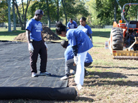 HU students lay foundation at the center's community vegetable garden.