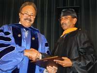 Dr. Sharad Maheshwari received the 2010 Edward L. Hamm Sr. award from HU President Dr. William R. Harvey.
